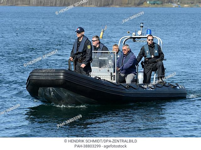 A diving unit of the police search for a diver, that is missing since one year, at the Cospudener Lake in Markkleeberg, Germany, 15 April 2013