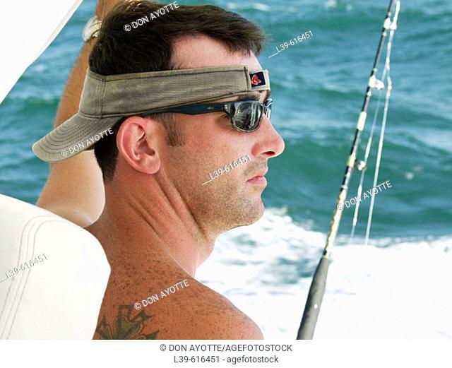 Guy on a deep sea fishing boat