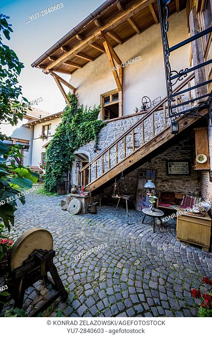 Courtyard of house in Historic Centre of Sighisoara city, Transylvania region in Romania