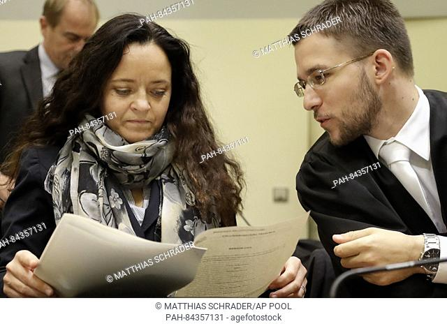 Terror suspect Beate Zschaepe arrives at the court room besides her lawyer Mathias Grasel in Munich, Germany, Thursday, Sept. 29, 2016