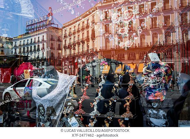 Reflections in a shop window, Puerta del Sol. Madrid, Spain