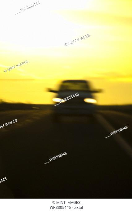 Blurred view of car on road at night