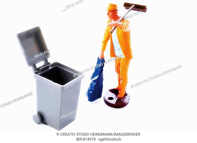 Toy garbage man and bin