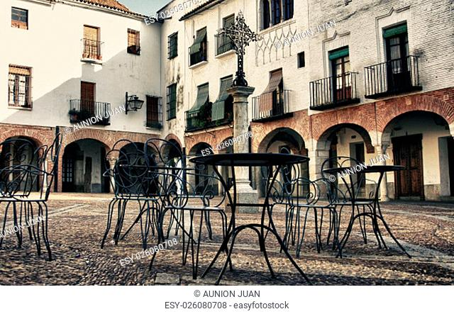 Plaza Chica, Small square of Zafra with pedestal tables, Badajoz, Spain. Vintage filtered