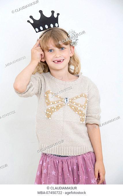 Child with crown on head, half portrait