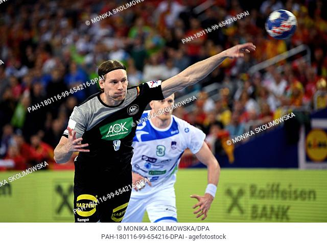 Germany's Tobias Reichmann throws the ball during the handball European Championships preliminary round match between Germany and Slovenia in the Arena in...