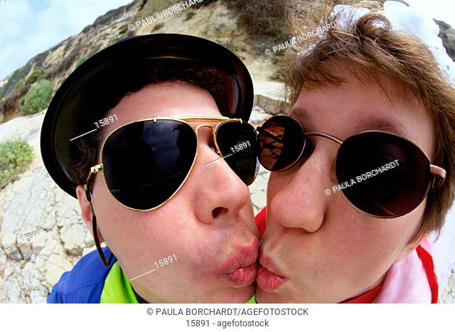 Funny portrait of couple kissing