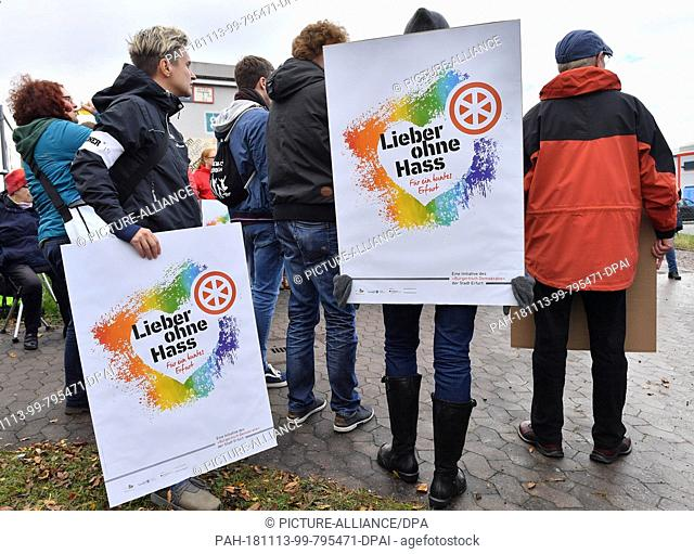 13 November 2018, Thuringia, Erfurt: Erfurt residents demonstrate during the laying of the foundation stone for a new mosque for the construction project