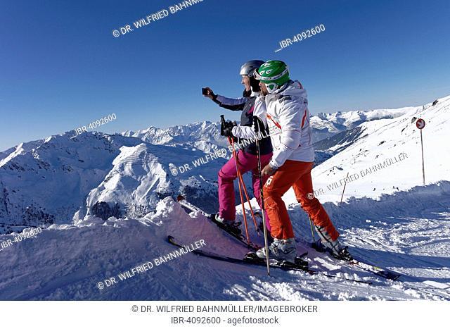 Skiers, couple taking a selfie, Hochfügen in Zillertal valley, Tyrol, Austria