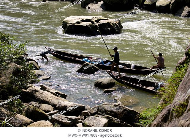 Boatmen navigating the rough Sangu river, at Tindumukh, in Thanchi, Bandarban, Bangladesh October 4, 2008