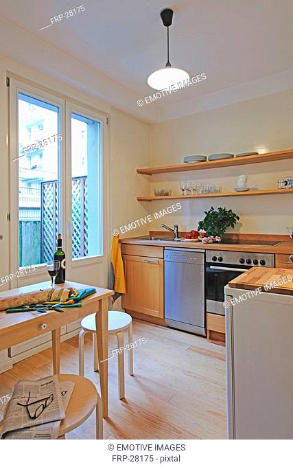 Kitchen with bottle of wine on table
