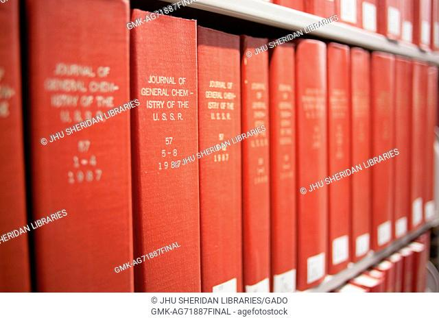 Photograph of red books on a shelf reading 'The Journal of General Chemistry of the USSR in volumes', 2014. Courtesy Eric Chen