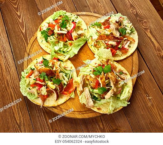Loaded Chicken Tostadas, topped with cheese, tomatoes, guacamole, olives and jalapenos are a great way to take nachos