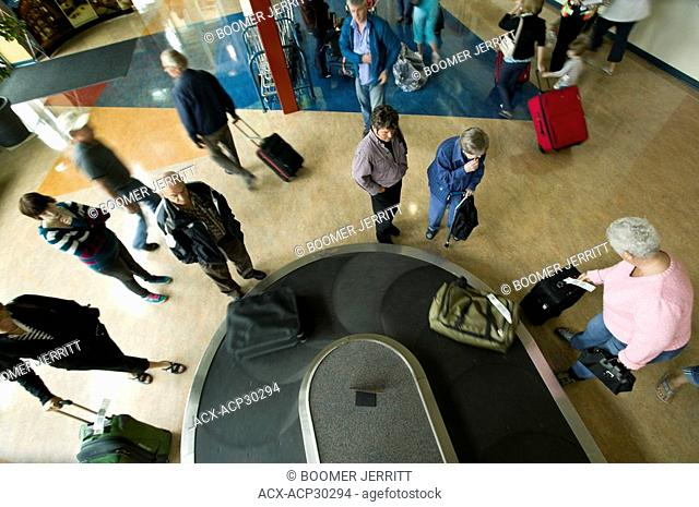 Passengers arriving at the Comox Airport YQQ await their baggage on one of the carousels located in the terminal. Comox, The Comox Valley, Vancouver Island