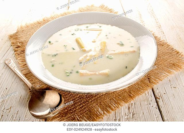 home made white asparagus soup with fresh parsley