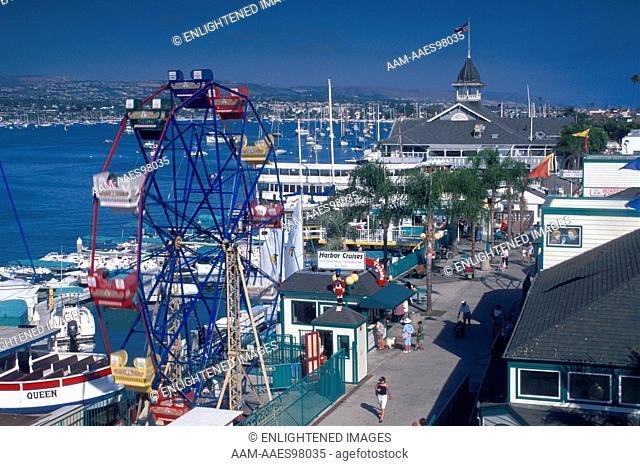Ferris wheel and promenade on waterfront at Balboa Island Funzone Amusement Park, Newport Beach, Orange County, California
