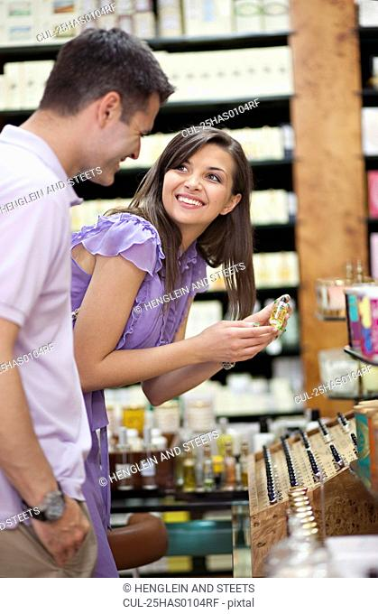 Young couple shopping in perfume store