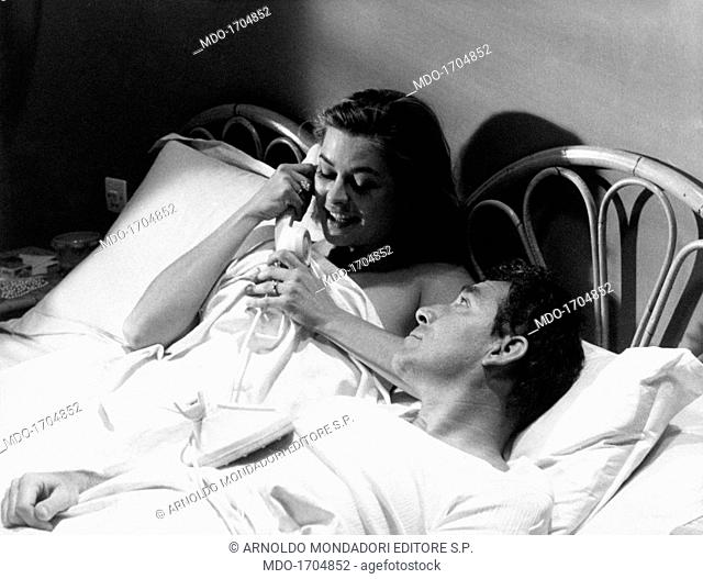 Ugo Tognazzi and Michèle Girardon under the sheets. The actor Ugo Tognazzi, as Andrea Artusi, lying on the bed next to Michèle Girardon, as Cristiana