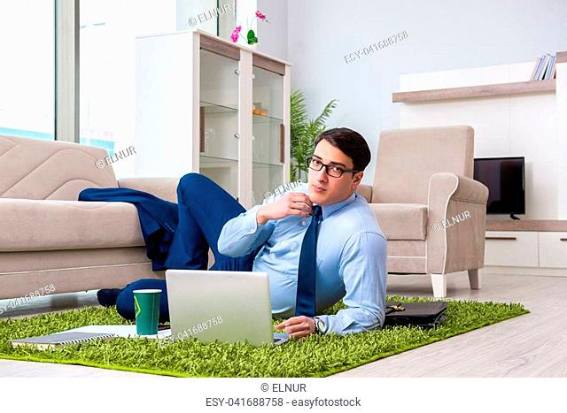 Businessman taking work home and working overtime