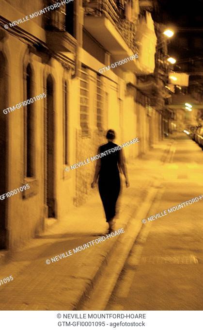 Woman walking alone on a street in Barcelona