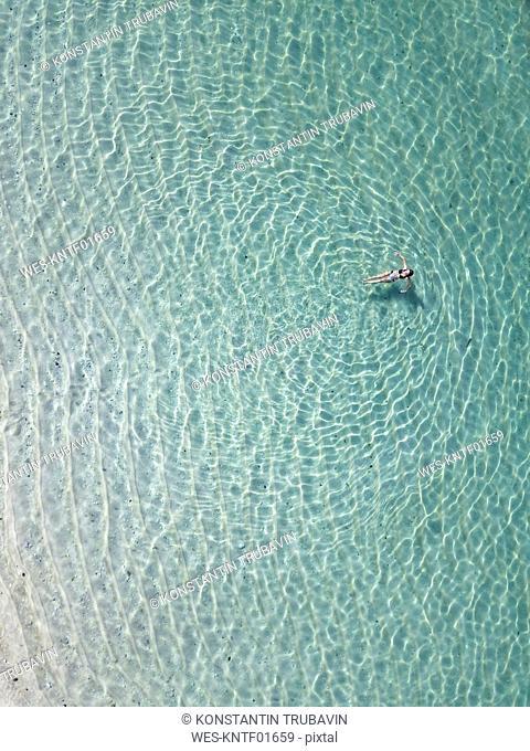 Indonesia, Bali, Melasti, Aerial view of Karma Kandara beach, woman in water