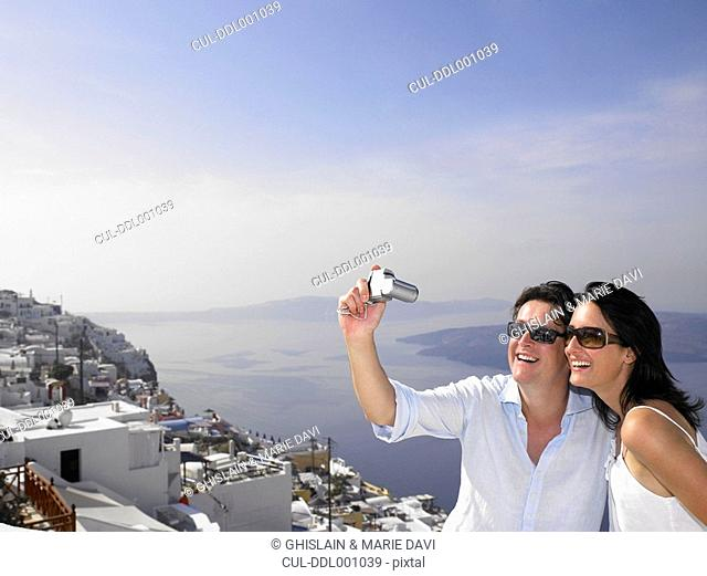 Couple taking pictures, sea view