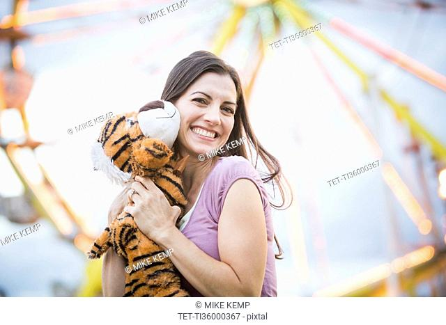 Portrait of woman with toy tiger