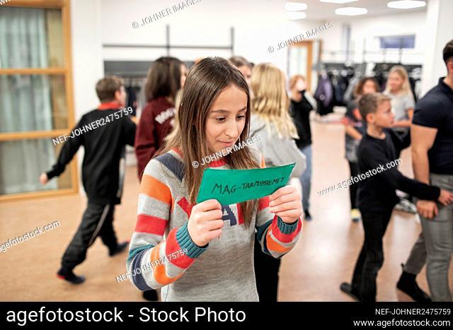 Girl standing at school corridor