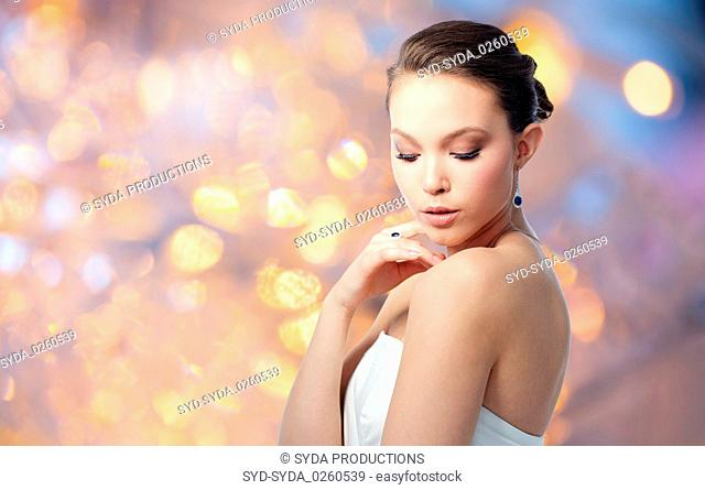 beautiful woman with earring and finger ring