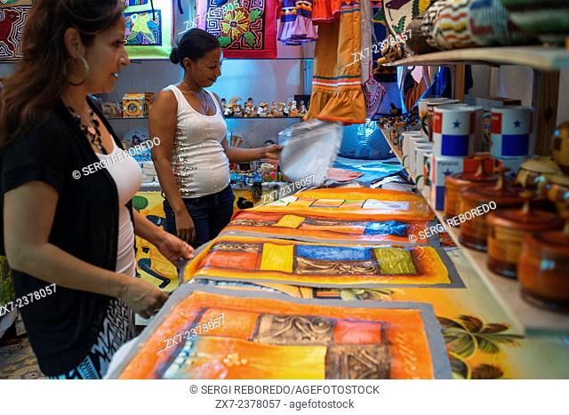 Inside Handicrafts market in old Panama City, Panama, Central America. A woman outside of the huge Mercado Nacional de Artesanias in Panama Viejo (beside the...