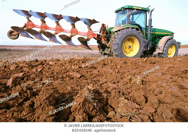 Tractor ploughing field. Spain