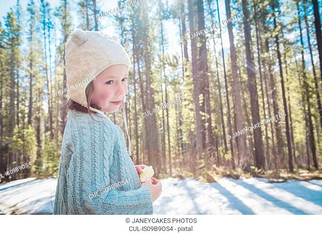 Girl with hat in forest, Alberta, Canada