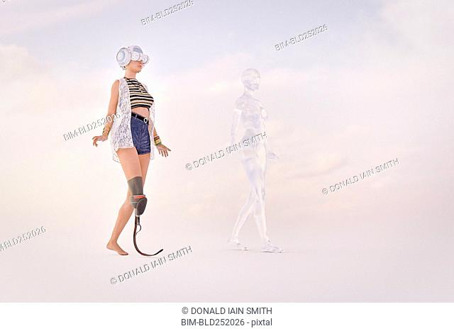 Woman with artificial leg wearing virtual reality goggles