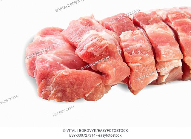 Raw Sliced Pork Meat Closeup Isolated On White Background