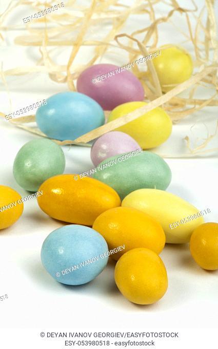 Small multicolored eggs white isolated
