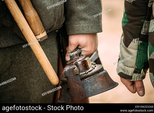 Close Up Of German Military Ammunition Of A German Wehrmacht Soldier. Re-enactor Dressed As World War II German Soldiers Holding Handy Siren, Alarm