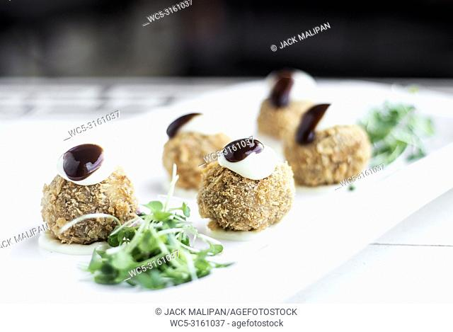 gourmet organic scotch quail eggs modern starter snack dish on table