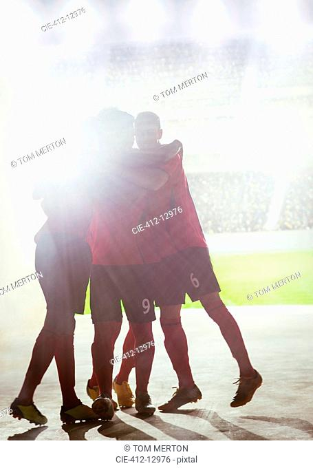 Silhouette of soccer team celebrating