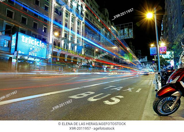 Traffic at Gran via street with lights trails effect at Christmas time. Madrid. Spain