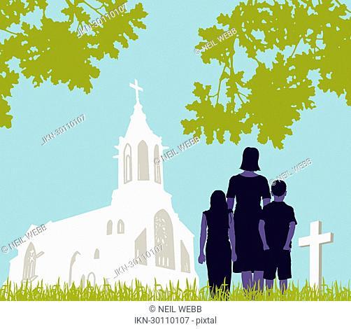 Family visiting graveyard
