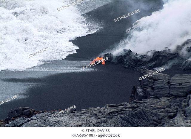 Hot lava flowing onto beach and into the ocean, Kilauea Volcano, Hawaii Volcanoes National Park, UNESCO World Heritage Site, Island of Hawaii Big Island, Hawaii
