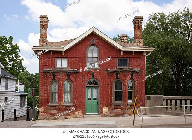 An old turn of the century red brick house in downtown Caledonia, Ontario, Canada