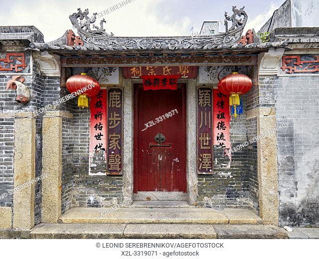 Old entrance door with red lanterns in Dafen Oil Painting Village. Shenzhen, Guangdong Province, China