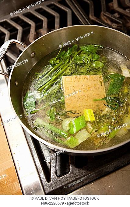 parmesan broth soup on stove top
