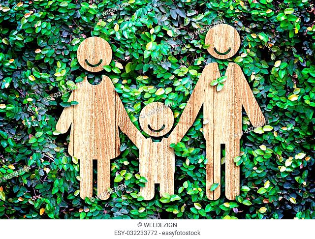 Happy family wood icon on green leaf wall,Eco concept