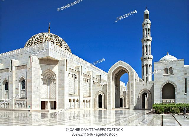 Architectural detail of the entrance courtyard and arch leading to the main prayer hall of the Sultan Qaboos Grand Mosque