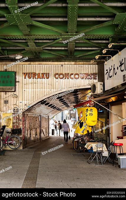 Underpass Yurakucho Concourse under the railway line of the station Yurakucho. Japanese noodle stalls and sake bars revive the nostalgic years of Showa air with...