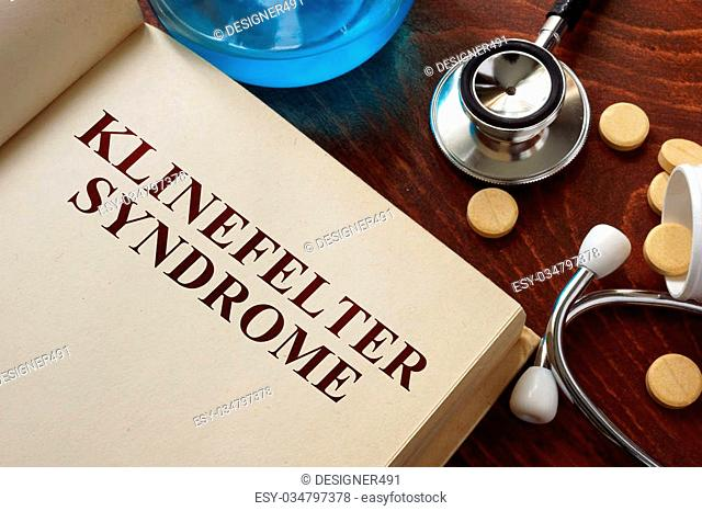 Klinefelter syndrome written on book with tablets. Medicine concept
