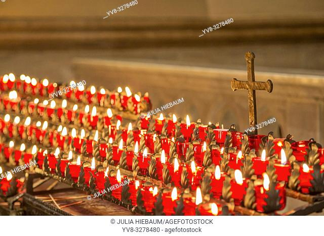 Burning candles inside Savannah's Cathedral of St. John the Baptist, Georgia