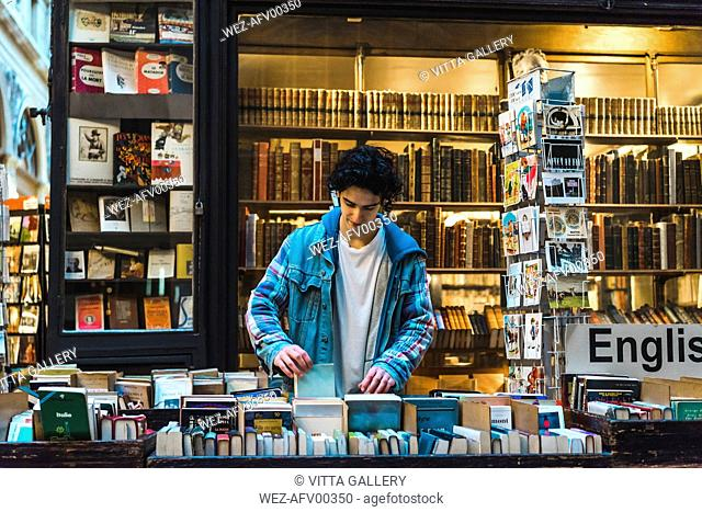 Young man in bookshop